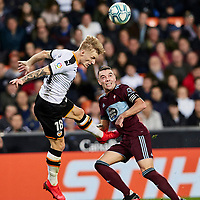 1st February 2020; Mestalla, Valencia, Spain; La Liga Football,Valencia versus Celta Vigo; Daniel Wass of Valencia CF clears a high ball challenged by Iago Aspas of Celta