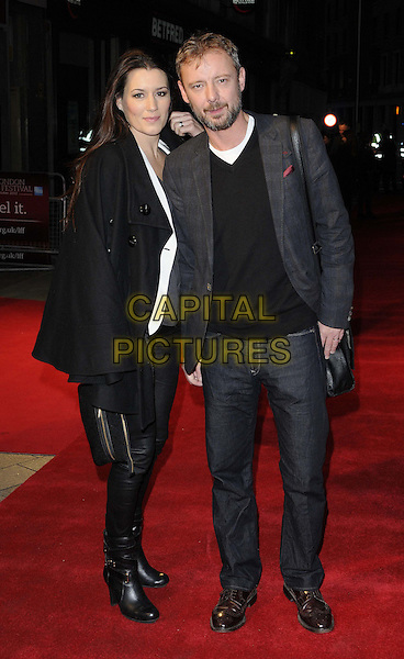 Kate Magowan & John Simm.The 'Everyday' official screening, the 56th BFI London Film Festival day 8, Odeon West End cinema, Leicester Square, London, England,.October 17th, 2012.full length black cape grey gray top leather trousers suit jacket jeans denim hand in pocket beard facial hair bag purse clutch boots married husband wife .CAP/CAN.©Can Nguyen/Capital Pictures.
