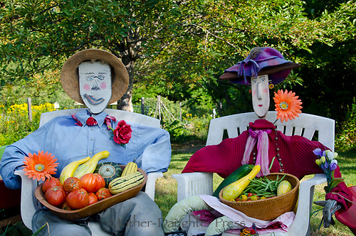 Wilma and Fred in community garden with harvest