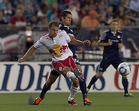 New York Red Bulls midfielder Teemu Tainio (2) passes the ball as New England Revolution forward Milton Caraglio (9) pressures. In a Major League Soccer (MLS) match, the New England Revolution tied New York Red Bulls, 2-2, at Gillette Stadium on August 20, 2011.