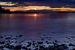 Dramatic sunset sky and ocean shore pebbles over the Strait of Georgia, Salish Sea, Pacific Ocean in Nanaimo, Vancouver Island, BC, Canada Image © MaximImages, License at https://www.maximimages.com