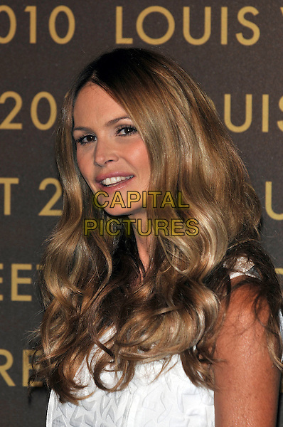 ELLE MACPHERSON .attends the launch of the Louis Vuitton Bond Street Maison Store in London, England, UK, May 25th, 2010. .portrait headshot white long wavy hair mouth open .CAP/PL.©Phil Loftus/Capital Pictures.