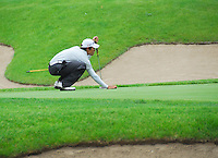 Memorial's Quinn Moe sets up to putt on the third hole at the 2008 WIAA state golf championship on Tuesday, 6/3/08, at University Ridge in Madison, Wisconsin