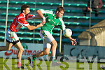 Fintan Coffey East Kerry tries to stop Alan O'Donoghye St Brendans in the first round of the county championship in Austin Stack park, Tralee on Friday.