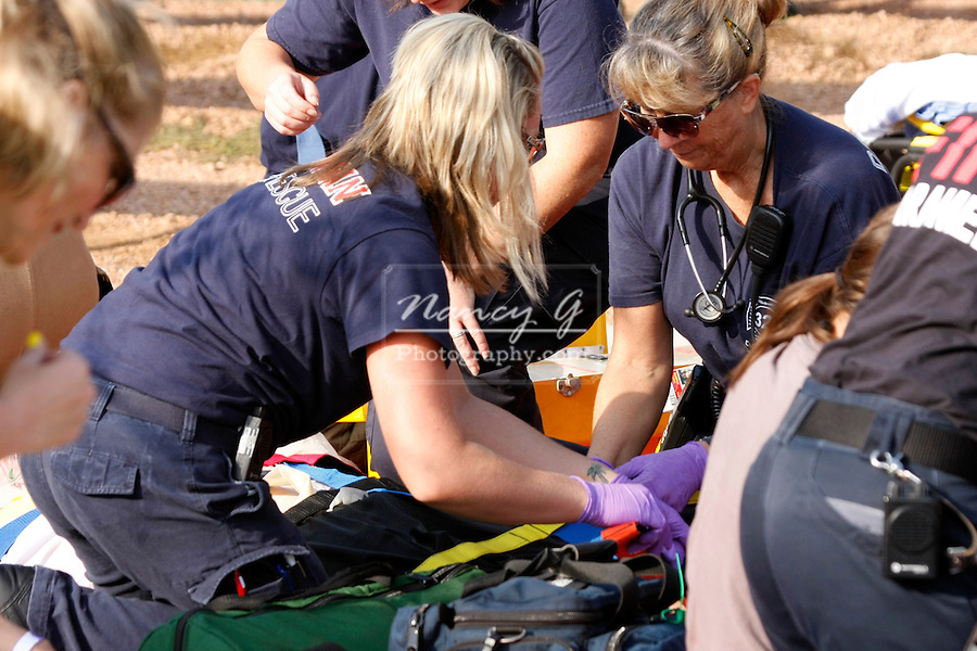 Emts working on victims at a mass casualty incident