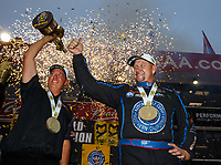 Nov 12, 2017; Pomona, CA, USA; NHRA pro stock driver Bo Butner (left) and funny car driver Robert Hight celebrate after clinching the 2017 championship during the Auto Club Finals at Auto Club Raceway at Pomona. Mandatory Credit: Mark J. Rebilas-USA TODAY Sports