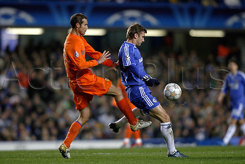 11 December 2007: Chelsea striker Andriy Shevchenko shields the ball from Ivan Helguera during the UEFA Champions League Group B game against Valencia at Stamford Bridge. Chelsea drew the game 0-0 Photo: Glyn Kirk/Action Plus...soccer football 071211 player