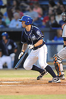 Asheville Tourists second baseman Michael Benjamin #18 swings at a pitch during opening night game against the Delmarva Shorebirds at McCormick Field on April 3, 2014 in Asheville, North Carolina. The Tourists defeated the Shorebirds 8-3. (Tony Farlow/Four Seam Images)