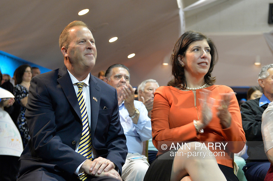 KEVIN LAW, Pres. and CEO of LIA, and Acting District Attorney of Nassau County MADELINE SINGAS, a Democrat, attend an event supporting extension of the NY Property Tax Cap. Long Island Association is a major organization for small business and large companies. At the bi-partisan event at Knights of Columbus Hall, over a hundred area residents and officials, and the governor, urged extending the property tax cap before the state legislative session ends on June 17. The NY Property Tax Cap is set to expire June 2016, but is legally linked to NYC rent-control regulations set to expire this month.