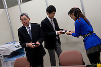 Artist, Rena Masuyama presents cards to officials from the Cabinet Office as organizers of the Anti nuclear protest by women outside the Ministry of Economy, Trade and Industry (METI) visit to present their demands. Tokyo Japan. Friday November 4th 2011. The protest ran from October 27th to Noverber 5th. Originally started my mothers from Fukushima protesting about nuclear contamination from October 30th to November 5th the protest welcomed women and people from all over Japan.