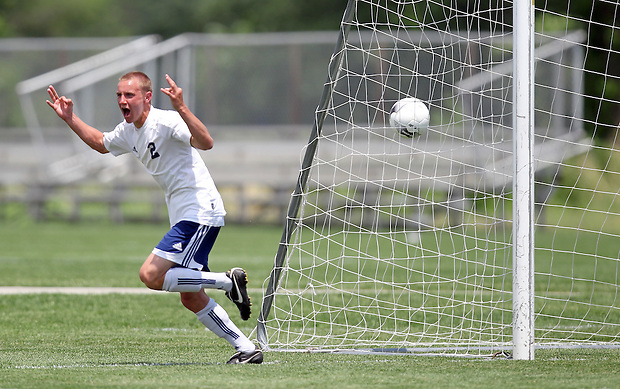 Iowa City Regina's Johhny Rummelhart celebrates his hat trick after scoring his third goal in the Regals' 3-0 win over Fort Madison Holy Trinity Catholic in the 1A state semifinal of the boys state soccer tournament in Des Moines. (Christopher Gannon/The Des Moines Register)