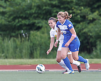 Boston Breakers forward Katie Schoepfer (12) dribbles as Western New York Flash defender Katherine Reynolds (16) defends. In a National Women's Soccer League Elite (NWSL) match, the Boston Breakers (blue) tied Western New York Flash (white), 2-2, at Dilboy Stadium on June 5, 2013.
