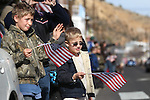 Blake, 10, and Alex Perry, 5, wave at participants in the Veteran's Day Parade in Virginia City, Nev., on Nov. 11, 2011..Photo by Cathleen Allison.