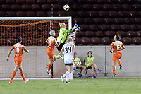 Houston, TX - Saturday July 08, 2017: Jane Campbell punches the ball away from her goal during a regular season National Women's Soccer League (NWSL) match between the Houston Dash and the Portland Thorns FC at BBVA Compass Stadium.