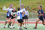 Redondo Beach, CA 05/14/11 - unidentified Cate players, Kelsey Patch (St Margaret #6) and Molly Wang (St Margaret #13) in action during the 2011 Division 2 US Lacrosse / CIF Southern Section Championship game between Cate School and St Margaret.