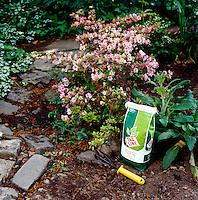 FERTILIZER BAG<br /> In A Garden<br /> Typical substances in fertilizer are ammonium nitrate, potassium sulfate and ammonium phosphate.