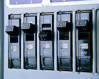 BANK OF CIRCUIT BREAKERS<br /> Protect Circuits from Overloading or Overheating<br /> Like the plug fuse, the device cuts off  electric current through a circuit under abnormal conditions to prevent fire and electrical shock.  Switch position indicates circuit is closed &amp; functioning. Each breaker handles up to 20 Amps of current.