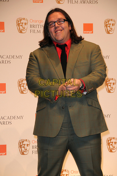 NICK FROST.The Orange British Academy Film Awards 2010 at the Royal Opera House Covent Garden, London, England, UK,.February 21st, 2010 .press awards room pressroom BAFTA BAFTAs half length suit blue tie green plaid red shirt khaki glasses smiling checked check .CAP/CAS.©Bob Cass/Capital Pictures