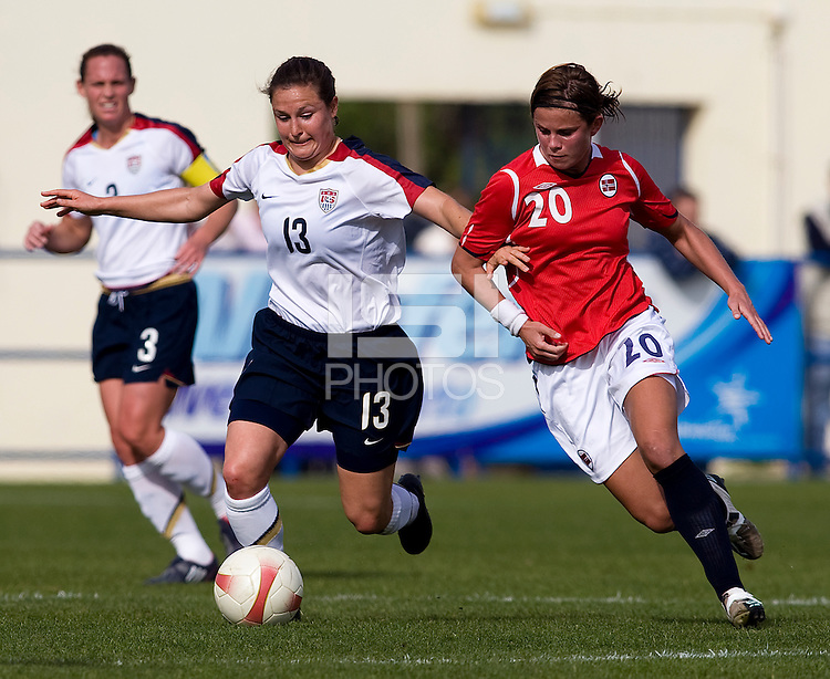USWNT defender (13) Kendall Fletcher fights for the ball with Norwegian forward (20) Kristin Lie during the last group stage game in the Algarve Cup.  The USWNT defeated Norway, 1-0, in Ferreiras, Portugal. Photo by Brad Smith/ isiphotos.com