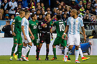 Seattle, WA - Tuesday June 14, 2016: Referee Victor Carrillo confronts Bolivia midfielder Jhasmani Campos (10) during a Copa America Centenario Group D match between Argentina (ARG) and Bolivia (BOL) at CenturyLink Field