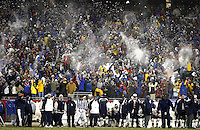 (12/7/03 Foxboro MA) NFL Week 14: New England Patriots  vs. Miami Dolphins. Patriot fans in unison toss snow in the air after Tedy Bruschi's TD in the 4th quarter.   (F05B3711.JPG - Staff Photo by Matthew West.  Saved in Monday and Daily Photo Archive)