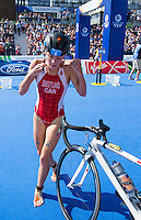 24 JUL 2014 - GLASGOW, GBR - Kirsten Sweetland (CAN) from Canada puts on her helmet as she prepares to leave transition during the elite women's 2014 Commonwealth Games triathlon in Strathclyde Country Park, in Glasgow, Scotland (PHOTO COPYRIGHT © 2014 NIGEL FARROW, ALL RIGHTS RESERVED)<br /> *******************************<br /> COMMONWEALTH GAMES <br /> FEDERATION USAGE <br /> RULES APPLY<br /> *******************************