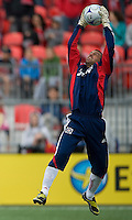 16 May 09: Chicago Fire goalkeeper Jon Busch #1 grabs a ball out of the air during action at BMO Field in a game between the Chicago Fire and Toronto FC..Chicago Fire won 2-0..