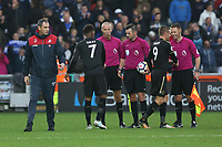 Swansea City manager Paul Clement walks away after shaking the hands of the match officials after the final whistle of the Premier League match between Swansea City and Leicester City at The Liberty Stadium, Swansea, Wales, UK. Saturday 21 October 2017