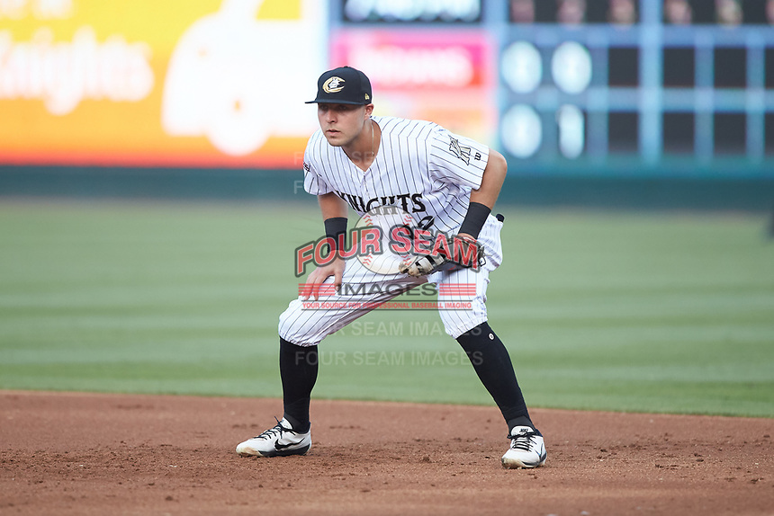 Charlotte Knights first baseman Matt Skole (12) on defense against the Indianapolis Indians at BB&T BallPark on May 26, 2018 in Charlotte, North Carolina. The Indians defeated the Knights 6-2.  (Brian Westerholt/Four Seam Images)
