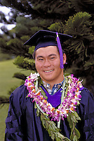 Japanese American college graduate student  from the University of Hawaii with leis