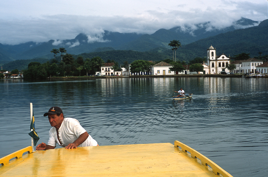 Retired fisherman Capitão Bené motors through the bays near Paratí, Brazil. Once the port for shipments of gold and gemstones from Brazil's interior to Portugal, Paratí still shows its colonial history.