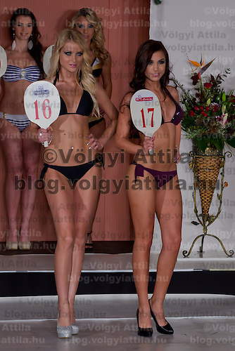 Evelin Beres (L) and Csilla Nigrinyi (R) participate the Miss Hungary beauty contest held in Budapest, Hungary on December 29, 2011. ATTILA VOLGYI