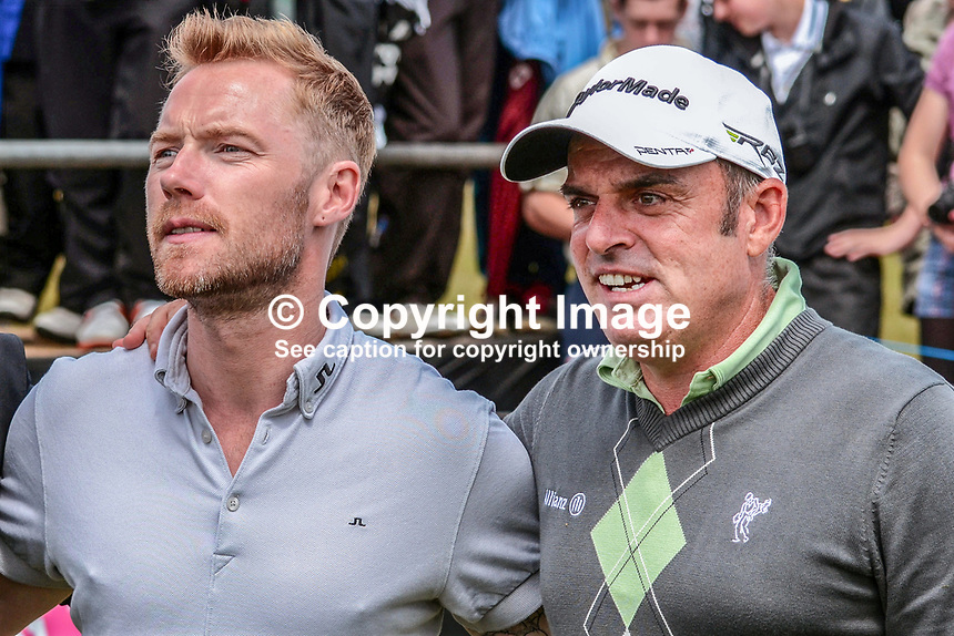 Ronan Keating, lead singer, Irish group, Boyzone, and Paul McGinley, professional golfer, Rep of Ireland, pose for a photo. Taken 27th June 2012 on the first tee, Pro-Am competition, Irish Open Championship, Royal Portrush Golf Club, N Ireland. 201206270342.<br />