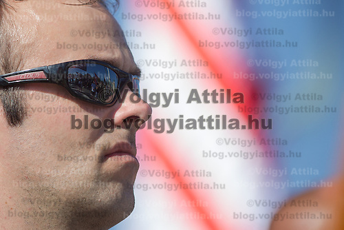 Demonstration is reflected on the sunglass of a participant as members of the unauthorized far-right Hungarian National Guard attend a gathering to commemorate the anniversary when their organization was formed in protest against the government in Budapest, Hungary on August 25, 2012. ATTILA VOLGYI