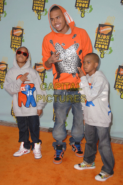 CHRIS BROWN & GUESTS .Attends The 2008 Kids Choice Awards held at Pauley Pavilion in Westwood, California, USA, March 29th 2008.                                                                     full length red orange hoodie top .CAP/DVS.©Debbie VanStory/Capital Pictures