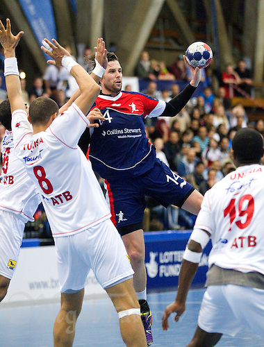 06 APR 2012 - LONDON, GBR - Great Britain's Steven Larsson (#14, in blue and red) passes during the men's 2012 London Cup match against Tunisia at the National Sports Centre in Crystal Palace, Great Britain (PHOTO (C) 2012 NIGEL FARROW)