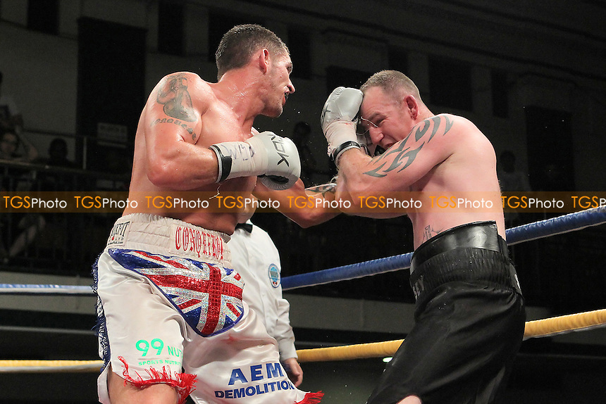 Tony Conquest (white shorts) defeats Ian Tims in a Cruiserweight boxing contest for the WBO European Title at York Hall, Bethnal Green, London, promoted by Queensberry Promotions - 07/09/12 - MANDATORY CREDIT: Gavin Ellis/TGSPHOTO - Self billing applies where appropriate - 0845 094 6026 - contact@tgsphoto.co.uk - NO UNPAID USE.