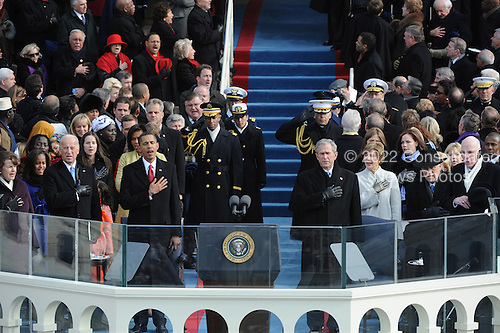 Washington, DC - January 20, 2009 -- United States President President Barack Obama and Vice President Joe Biden sings the national anthem at the end of swearing-in ceremonies after being sworn in as the 44th President of the United States in Washington, DC, USA 20 January 2009. Obama defeated Republican candidate John McCain on Election Day 04 November 2008 to become the next U.S. President.Credit: Pat Benic - Pool via CNP