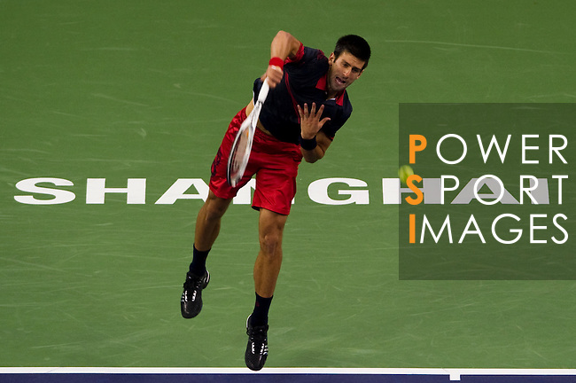 SHANGHAI, CHINA - OCTOBER 13:  Novak Djokovic of Serbia serves to Ivan Ljubicic of Croatia during day three of the 2010 Shanghai Rolex Masters at the Shanghai Qi Zhong Tennis Center on October 13, 2010 in Shanghai, China.  (Photo by Victor Fraile/The Power of Sport Images) *** Local Caption *** Novak Djokovic
