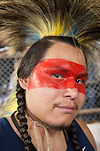 A Native American contestant from the USA wears red face paint during the International Indigenous Games in Brazil. 27th October 2015