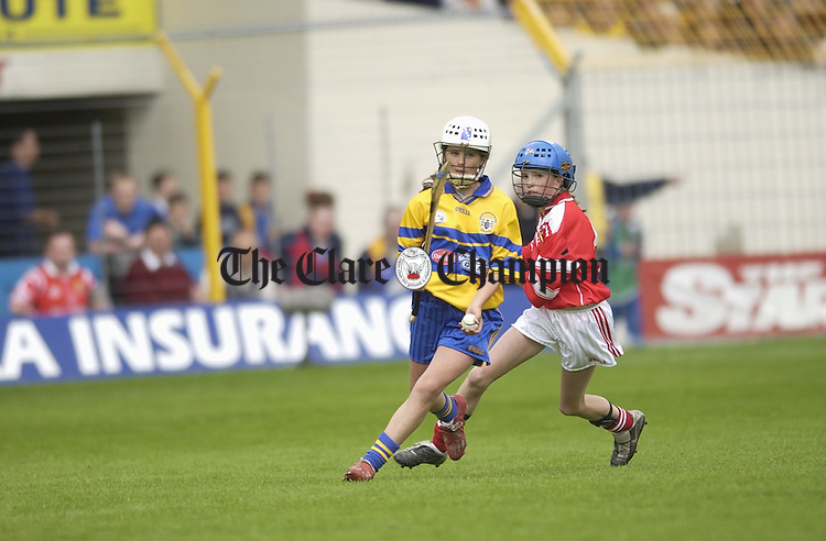 Clare's Olivia Tierney in possession against Cork's Sinead O Callaghan during the primary game in Thurles. Photograph by John Kelly.