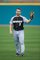 Buck McCarthy (3) of the Bryant Bulldogs warms up in the outfield prior to the game against the Coastal Carolina Chanticleers at Springs Brooks Stadium on March 13, 2015 in Charlotte, North Carolina.  The Chanticleers defeated the Bulldogs 7-2.  (Brian Westerholt/Four Seam Images)