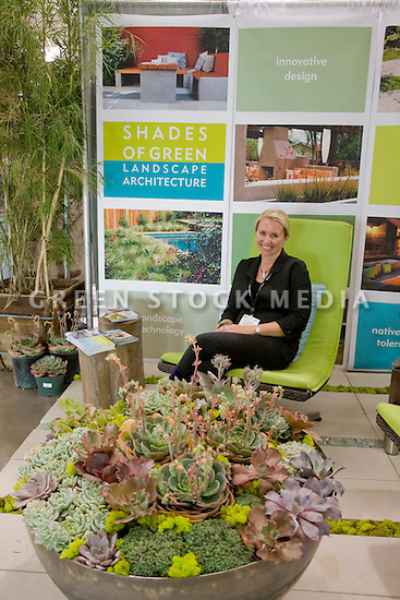 Ive Haugeland, Principal, Shades of Green Landscape Architecture, at her well landscaped trade show booth. West Coast Green is the nation?s largest conference and expo dedicated to green innovation, building, design and technology. The conference featured over 380 exhibitors, 100 presenters, and 14,000 attendees. Location: San Jose Convention Center in Silicon Valley (San Jose, California, USA), September 25-27, 2008