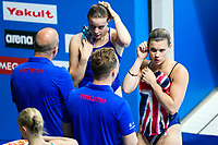 Picture by Rogan Thomson/SWpix.com - 17/07/2017 - Diving - Fina World Championships 2017 -  Duna Arena, Budapest, Hungary - Grace Reid and Katherine Torrance of Great Britain speak to thir coaches during the warmup for the Women's 3m Synchronised Springboard Preliminary.