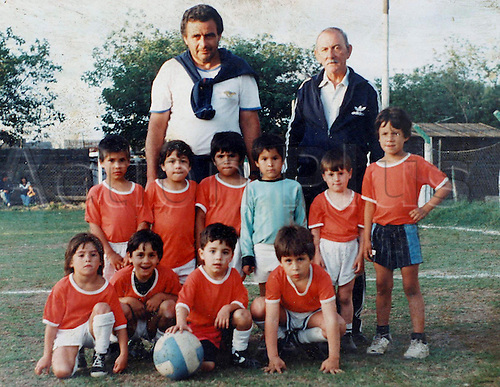 An undated picture shows Lionel Messi (left to right 5th standing) at age 4 and his coach Salvador Aparicio (left to right 2nd stand), with the childrens football team of club Grandoli.