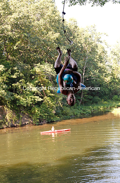 Southbury, CT-05, June 2010-070510CM01  Josh Linley, of Monroe flips off a rope swing next to Southbury Town Beach Monday afternoon in Southbury.  Linley was with a group of friends trying to beat the heat.  The hot weather continues today (Tuesday), with a suspected heat index of 100 degrees.  --Christopher Massa Republican-American