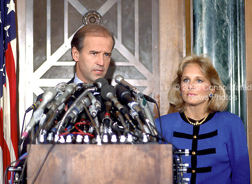 Washington, D.C. - September 27, 1987 -- United States Senator Joseph Biden (Democrat of Delaware) his intention to withdraw from the race for the Democratic nomination for of the United States in 1988 in Washington, D.C. on September 27, 1987. At right is his wife, Jill..Credit: Arnie Sachs / CNP