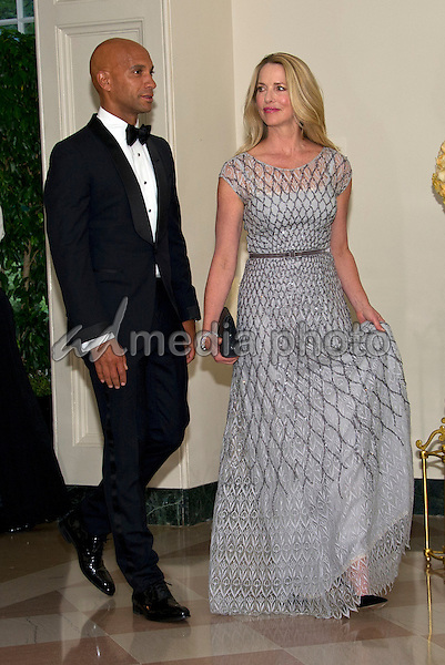 Laurene Powell Jobs, Founder, Emerson Collective, and former Mayor Adrian Fenty (Democrat of Washington, DC) arrive for the State Dinner honoring Prime Minister Lee Hsien Loong of the Republic of Singapore at the White House in Washington, DC on Tuesday, August 2, 2016. Photo Credit: Ron Sachs/CNP/AdMedia