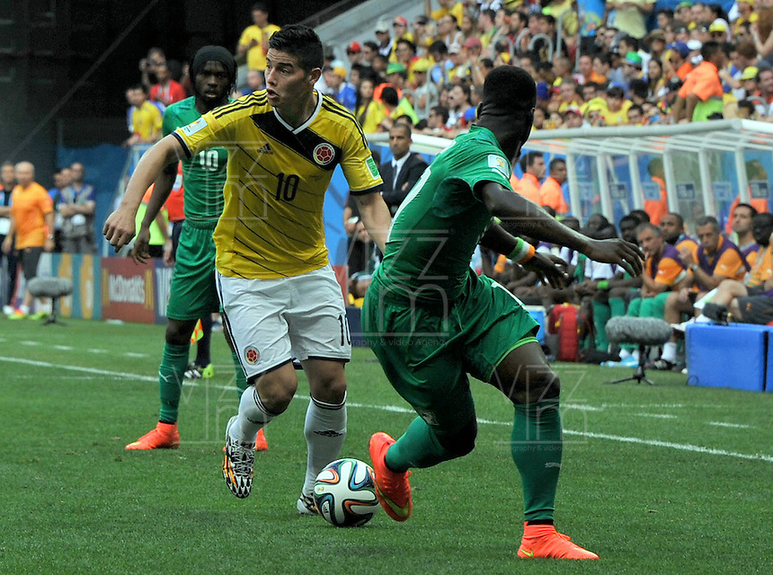 BRASILIA - BRASIL -19-06-2014. James Rodríguez jugador de Colombia (COL) en acción durante partido del Grupo C contra Costa de Marfil (CIV) por la Copa Mundial de la FIFA Brasil 2014 jugado en el estadio Mané Garricha de Brasilia./ James Rodriguez player of Colombia (COL) in action during the macth of the Group C against Costa de Marfil (CIV) for the 2014 FIFA World Cup Brazil played at Mane Garricha stadium in Brasilia. Photo: VizzorImage / Alfredo Gutiérrez / Contribuidor