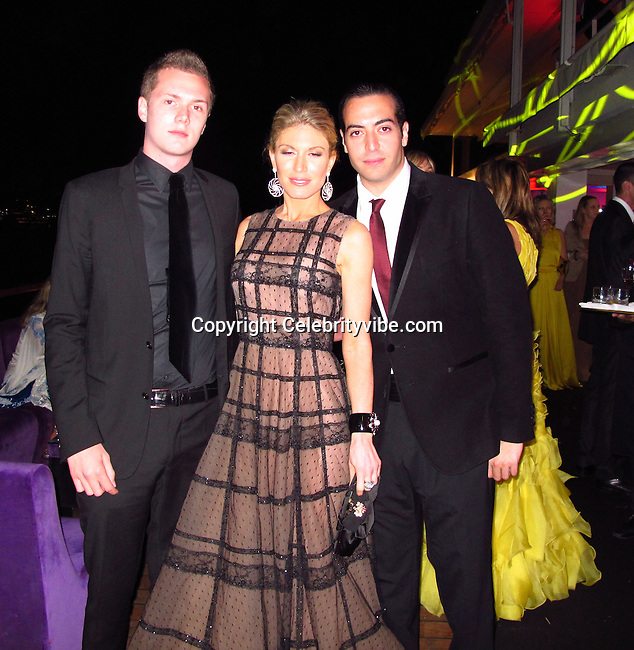 Barron Hilton, Hofit Golan and Mohammed Al Turki..De Grisogno Party..2011 Cannes Film Festival..Eden Roc Restaurant at Hotel Du Cap..Cap D'Antibes, France..Tuesday, May 17, 2011..Photo By CelebrityVibe.com..To license this image please call (212) 410 5354; or.Email: CelebrityVibe@gmail.com ;.website: www.CelebrityVibe.com